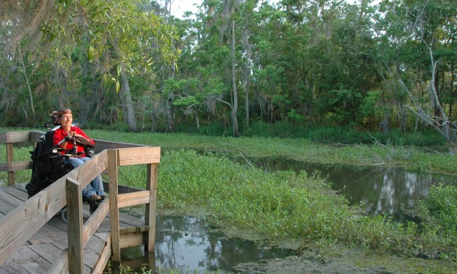 Me, on boardwalk, overlooking bayou, in evening light.